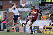 Millwall FC midfielder Ben Thompson (24)  blocks the clearance from Bradford City defender Stephen Darby (2)  during the Sky Bet League 1 match between Bradford City and Millwall at the Coral Windows Stadium, Bradford, England on 26 March 2016. Photo by Simon Davies.