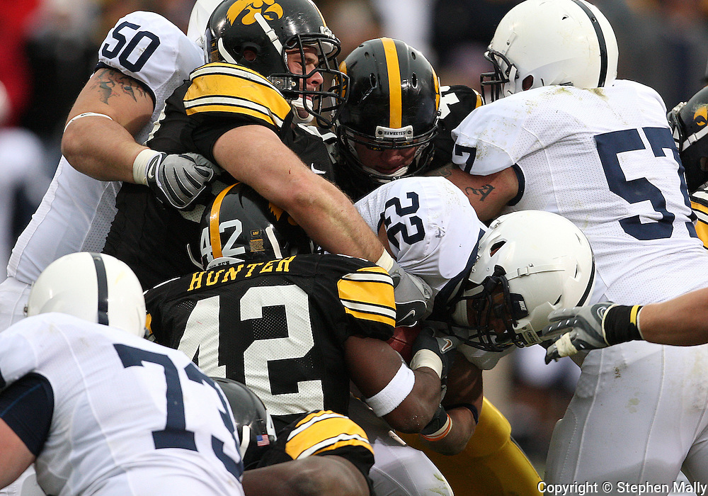 08 NOVEMBER 2008: Penn State running back Evan Royster (22) is hit by the Iowa defenders in the first half of an NCAA college football game against Penn State, at Kinnick Stadium in Iowa City, Iowa on Saturday Nov. 8, 2008. Iowa beat Penn State 24-23.