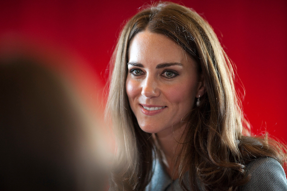 Catherine the Duchess of Cambridge smiles during a meeting with veterans at the War Museum in Ottawa, Canada,  July 2, 2011.<br /> AFP PHOTO/GEOFF ROBINS