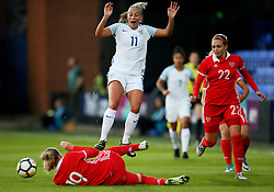 Ekaterina Morozova of Russia tackles Toni Duggan of England - Mandatory by-line: Matt McNulty/JMP - 19/09/2017 - FOOTBALL - Prenton Park - Birkenhead, United Kingdom - England v Russia - FIFA Women's World Cup Qualifier