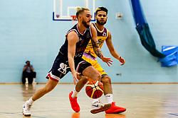 Jordan Nicholls of Bristol Flyers takes on Jordan Spencer of London Lions - Photo mandatory by-line: Robbie Stephenson/JMP - 10/04/2019 - BASKETBALL - UEL Sports Dock - London, England - London Lions v Bristol Flyers - British Basketball League Championship