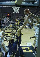 January 14, 2011: Michigan Wolverines forward Jordan Morgan (52) and Iowa Hawkeyes guard/forward Roy Devyn Marble (4) battle for a rebound during the NCAA basketball game between the Michigan Wolverines and the Iowa Hawkeyes at Carver-Hawkeye Arena in Iowa City, Iowa on Saturday, January 14, 2011. Iowa defeated Michigan 75-59.