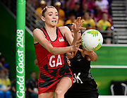 11th April 2018, Gold Coast Convention and Exhibition Centre, Gold Coast, Australia; Commonwealth Games day 7; Netball, England versus New Zealand; Helen Housby of England catches a pass as Temalisi Fakahokotau of New Zealand attempts to block
