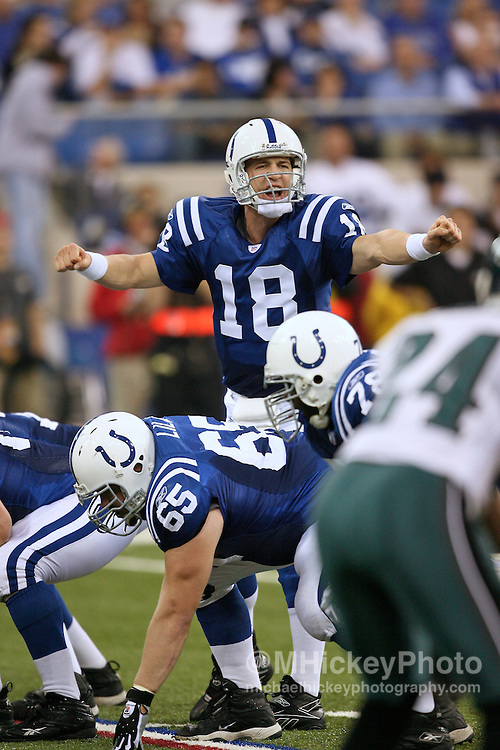 WireImage #11583956--Indianapolis quarterback Peyton Manning calls signals at the line of scrimmage during game between the Philadelphia Eagles and Indianapolis Colts at the RCA Dome in Indianapolis, Indiana on November 26, 2006.