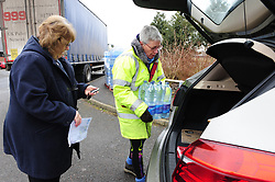 © Licensed to London News Pictures.05/03/2018<br /> Lenham, UK.<br /> Local Cllr Janetta Sams hand out water.<br /> Bottled water delivered to Northdown Close in Lenham.<br /> 7000 homes in Lenham and Ashford in Kent without water as thawing pipes burst after the big freeze.<br /> Photo credit: Grant Falvey/LNP