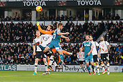 Derby County goalkeeper Scott Carson (1) makes a finger tip save to prevent Wigan Athletic midfielder Michael Jacobs (17) during the EFL Sky Bet Championship match between Derby County and Wigan Athletic at the iPro Stadium, Derby, England on 31 December 2016. Photo by Richard Holmes.