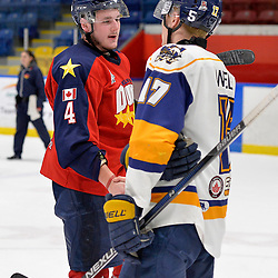 WHITBY, ON  - MAR 14,  2017: Ontario Junior Hockey League, playoff game between the Whitby Fury and Wellington Dukes. Brody Morris #4 of the Wellington Dukes shakes hands with Brock Welsh #17 of the Whitby Fury.<br /> (Photo by Shawn Muir / OJHL Images)