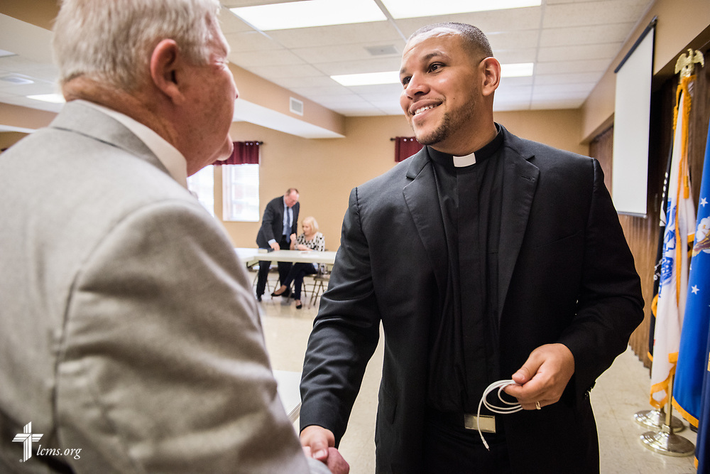 The Rev. Micah Glenn, national missionary to Ferguson, Mo., talks with supporter Bill Adams following Glenn's presentation at Trinity Lutheran Church on Sunday, April 2, 2017, in Cape Girardeau, Mo. LCMS Communications/Erik M. Lunsford