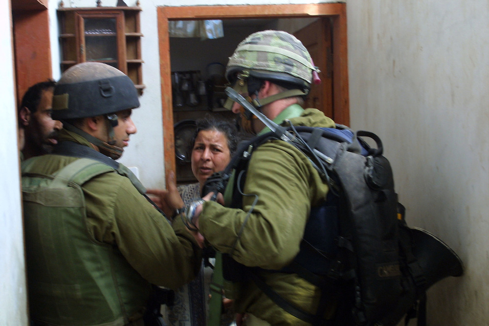 Israeli forces on operations in Han Unes refuge camp near by the Philadelphi Road to fined tunnels that smugglings weapon to the Gaza strip ....Israeli forces investigate refuge for locate tunnels .. **UK OUT**
