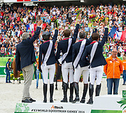 Team France win silver in the team test<br /> Alltech FEI World Equestrian Games™ 2014 - Normandy, France.<br /> © DigiShots