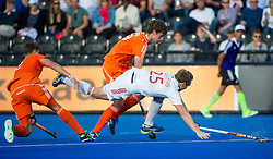 England's Chris Griffiths is brought down by Sander De Wijn of the Netherlands. England v Netherlands  - Unibet EuroHockey Championships, Lee Valley Hockey & Tennis Centre, London, UK on 23 August 2015. Photo: Simon Parker