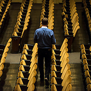 June 3, 2014 - New York, NY : As part of the New York Philharmonic Biennial, the orchestra solicited pieces from little-known composers and will choose three to play. Pictured here, William Dougherty, one of the composers whose work is being auditioned, walks down a row of seats in Avery Fisher Hall on Tuesday, where the orchestra rehearsed the six finalists's pieces. CREDIT: Karsten Moran for The New York Times