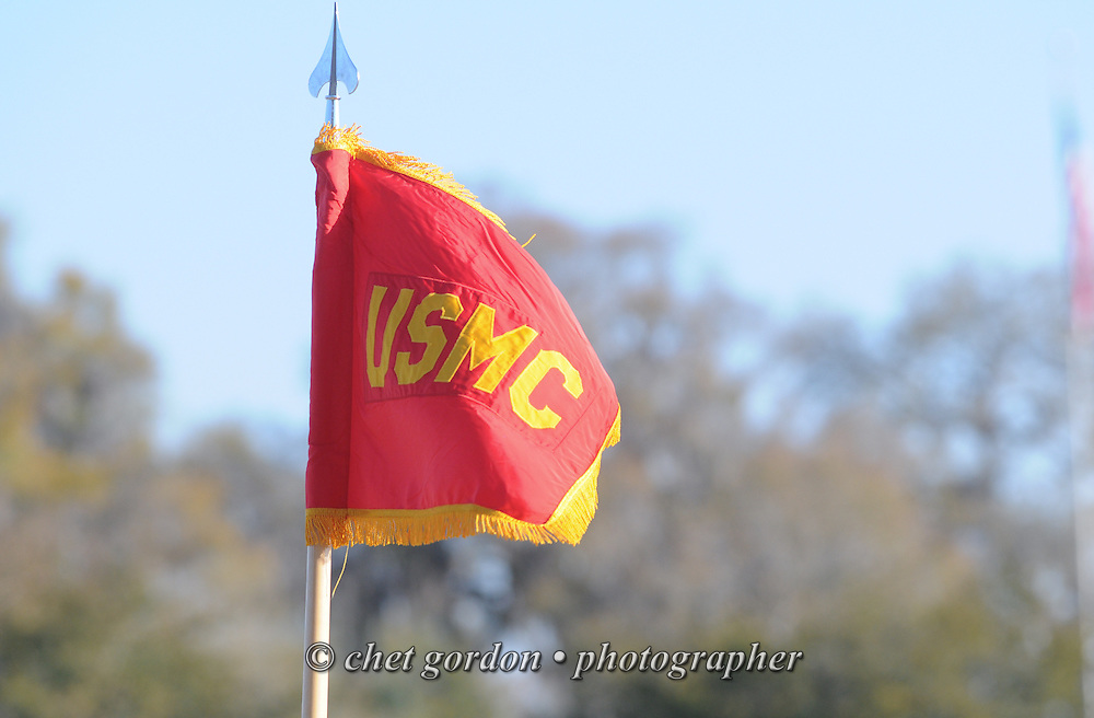 A Marine Corps guidon flag flies on the parade deck during a graduation ceremony at the Marine Corps Recruit Depot (MCRD) in Parris Island, SC on Friday, March 15, 2013.