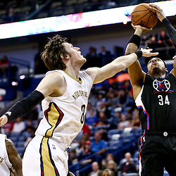 Mar 20, 2016; New Orleans, LA, USA; Los Angeles Clippers forward Paul Pierce (34) shoots over New Orleans Pelicans forward Luke Babbitt (8) during the first quarter of a game at the Smoothie King Center. Mandatory Credit: Derick E. Hingle-USA TODAY Sports