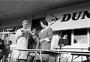 Mrs Christy O'Connor (left) presenting a bouquet on behalf of the I.P.G.A. to Mrs John Sheridan, wife of the Marketing Director of Irish Dunlop Co. after the Irish Dunlop £1,000 Tournament at Tramore Golf Club, Co. Waterford on the 19th August 1967.