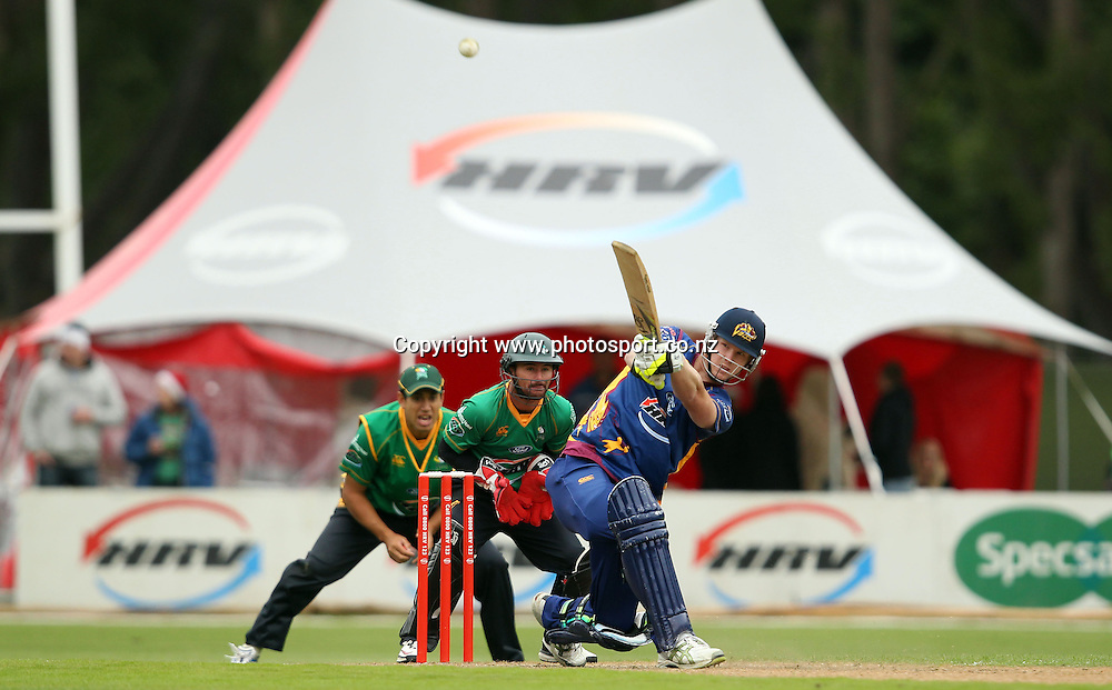 Jimmy Neeshan hits a six through mid-wicket for the Volts.<br /> Twenty20 Cricket - HRV Cup, Otago Volts v Central Stags, 18 December 2011, University Oval, Dunedin, New Zealand.<br /> Photo: Rob Jefferies/PHOTOSPORT