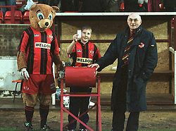 MASCOT, WITH CHAIRMAN PETER MALLINGER AND ROCKY DRAW THE KLONDYKE AT HALF TIME, Kettering v Hull City, FA Cup,  Rockingham Road, Saturday 18th November 2000