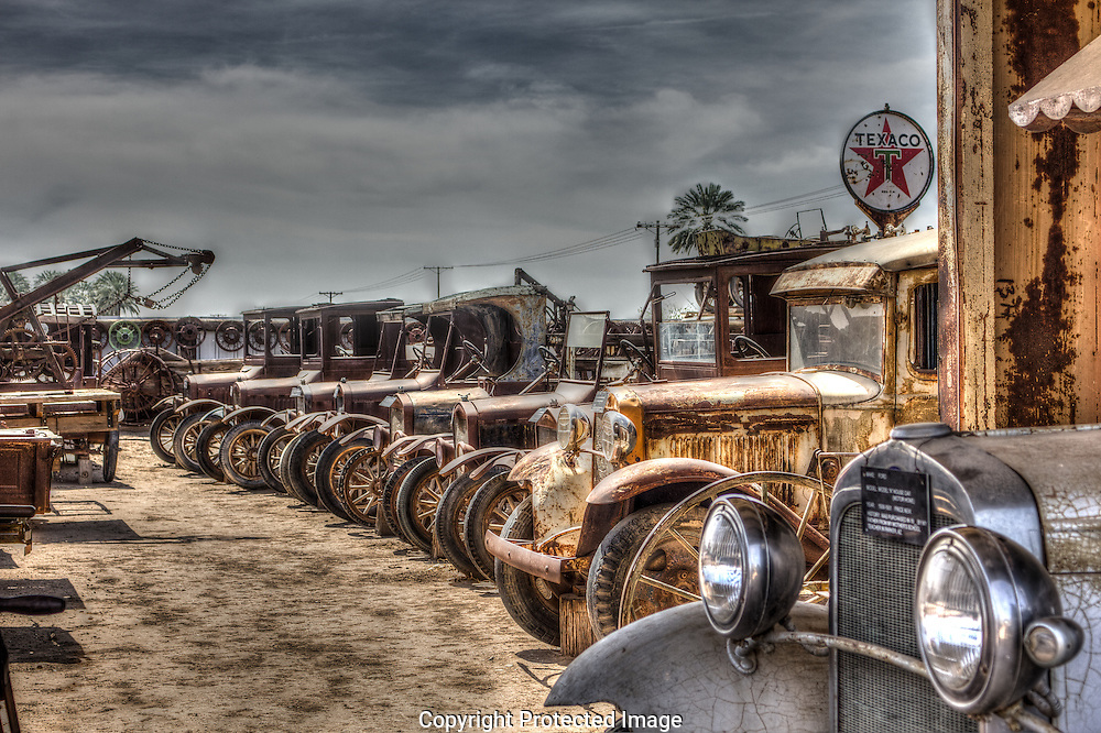 Model A  and Model T Fords parked among the Cloud Museum's antique vehicles.  The Cloud Museum is located in Bard, California near Yuma, Arizona