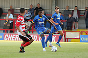 Christian Toonga during the match between Kingstonian and AFC Wimbledon at the Cherry Red Records Stadium, Kingston, England on 30 July 2015. Photo by Stuart Butcher.