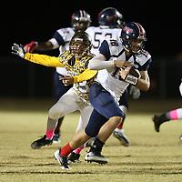 Baldwyn quarterbackJohn Swinney runs the ball on the quarterback keeper in the second quarter against East Union Thursday night.