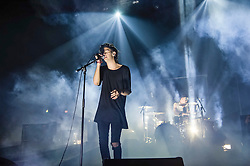 "© Licensed to London News Pictures. 09/01/2014. London, UK.   The 1975 performing live at Brixton Academy.  In this picture - Matthew Healy (left) and George Daniel (right). . The 1975 are an English alternative rock/indie rock band from consisting of members Matthew Healy (vocals, guitar), Adam Hann (guitar), George Daniel (drums), and Ross MacDonald (bass).  They are touring to promote their debut studio album ""The 1975"".  Photo credit : Richard Isaac/LNP"
