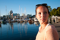 Taylor (20) enjoys the view of the Inner Harbour of Victoria on a summer evening.