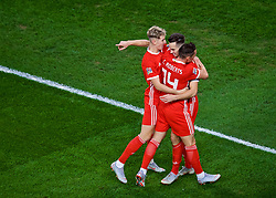 CARDIFF, WALES - Thursday, September 6, 2018: Wales' Tom Lawrence celebrates scoring the first goal with team-mates David Brooks and Connor Roberts during the UEFA Nations League Group Stage League B Group 4 match between Wales and Republic of Ireland at the Cardiff City Stadium. (Pic by Laura Malkin/Propaganda)
