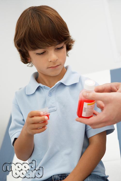 Boy taking medicine