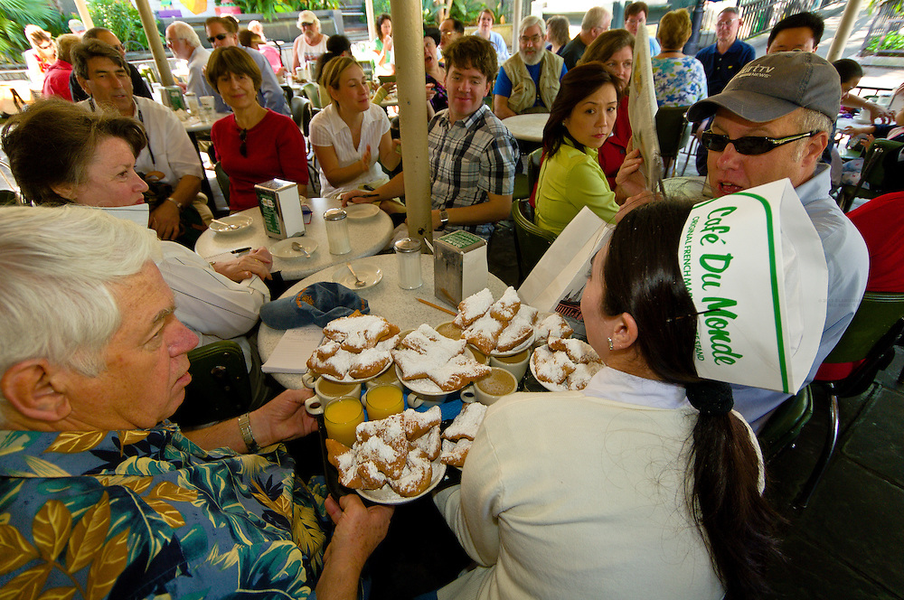 Waitress carrying order of beignets and coffee, Cafe du Monde, French Quarter, New Orleans, Louisiana, USA
