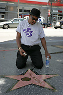 15th May 2008, Hollywood, Califorinia. Tito Jackson from the 'Jackson Five' gets down on his hands and knees to clean the families star on the Hollywood Walk Of Fame. PHOTO © JOHN CHAPPLE / REBEL IMAGES.john@chapple.biz     www.chapple.biz