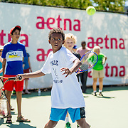 August 22, 2016, New Haven, Connecticut: <br /> A fan participates in the Free Tennis Lesson in the Aetna Fit Zone during Day 4 of the 2016 Connecticut Open at the Yale University Tennis Center on Monday August  22, 2016 in New Haven, Connecticut. <br /> (Photo by Billie Weiss/Connecticut Open)