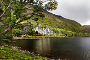 General view of Kylemore Abbey, 1867, by James Franklin Fuller and Samuel Ussher Roberts, Connemara, Ireland. Kylemore Abbey, founded in 1920 for Benedictine Nuns who fled Belgium during World War I, was originally a private castle built on the shore of Lough Pollacappul for Mitchell and Margaret Henry, a wealthy couple from Manchester.  The name Kylemore derives from the Irish Coill Mhor, or Great Wood. Picture by Manuel Cohen