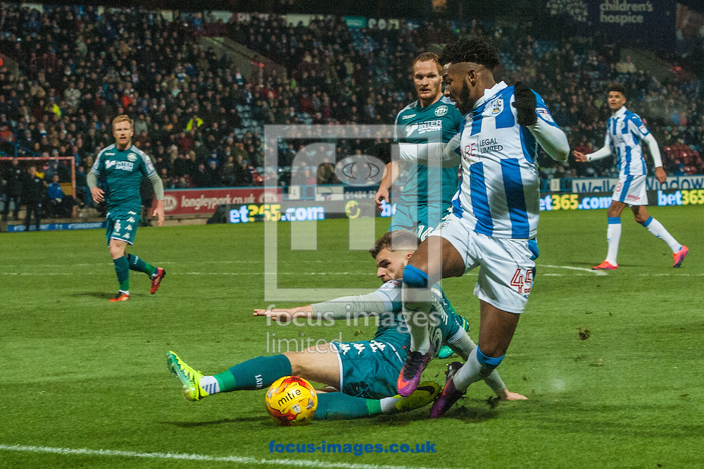 Kasey Palmer of Huddersfield Town is tackled by Luke Garbutt of Wigan Athletic during the Sky Bet Championship match at the John Smiths Stadium, Huddersfield<br /> Picture by Matt Wilkinson/Focus Images Ltd 07814 960751<br /> 28/11/2016