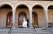"Bride Patricia Ann O'Grady outside Sacred Heart Church prior to her wedding ceremony in Yonkers, NY on Friday, September 6, 2002. Quote from Best Man, Dennis Meyers; ""Together forever in health and happiness, Greg and Tricia, forever."" (Photograph by Chet Gordon for The New York Daily News)"