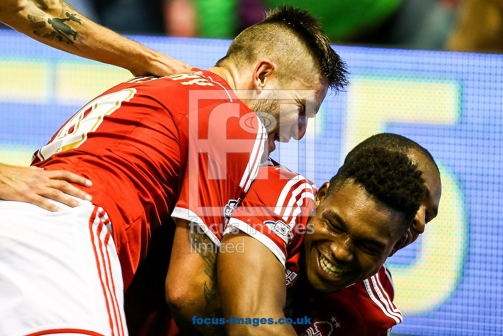Britt Assombalonga of Nottingham Forest (right) celebrates after scoring the fourth goal for Forest during the Sky Bet Championship match at the City Ground, Nottingham<br /> Picture by Andy Kearns/Focus Images Ltd 0781 864 4264<br /> 17/09/2014