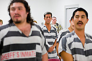 "06 NOVEMBER 2006 - PHOENIX, AZ: Prisoners in the Maricopa County Jail in Phoenix, AZ, take English classes offered to Spanish speaking prisoners in the jail. Maricopa County Sheriff Joe Arpaio is offering intensive two week English classes in the Maricopa County Jails so county prisoners can communicate with Detention Officers. The classes teach ""jail English"" so inmates can report medical problems, request their lawyers, request bedding etc. There are more than 1,000 illegal immigrants in the county jail system. In 2011, the US Department of Justice issued a report highly critical of the Maricopa County Sheriff's Department and the jails. The DOJ said the Sheriff's Dept. engages in widespread discrimination against Latinos during traffic stops and immigration enforcement, violates the rights of Spanish speaking prisoners in the jails and retaliates against the Sheriff's political opponents.      PHOTO BY JACK KURTZ"