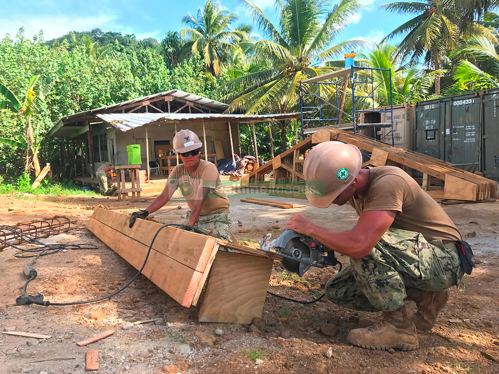 KOSRAE, Federated States of Micronesia (May 11, 2017) Utilitiesman 2nd Class Christopher Boughton, right, from Clayton, N.C., and Construction Electrician 2nd Class Daniela Acevedo, from Crystal Lake, Ill., cut form work for a bond beam for the Naval Mobile Construction Battalion (NMCB) 1 Walung Health Clinic project in Kosrae, Federated States of Micronesia. NMCB-1 is forward deployed to execute construction, humanitarian and foreign assistance, special operations combat service support, and theater security cooperation in support of U.S. Pacific Command. (U.S. Navy photo by Utilitiesman Constructionman Matthew Konopka/Released)170511-N-ZZ054-059<br /> Join the conversation:<br /> http://www.navy.mil/viewGallery.asp<br /> http://www.facebook.com/USNavy<br /> http://www.twitter.com/USNavy<br /> http://navylive.dodlive.mil<br /> http://pinterest.com<br /> https://plus.google.com