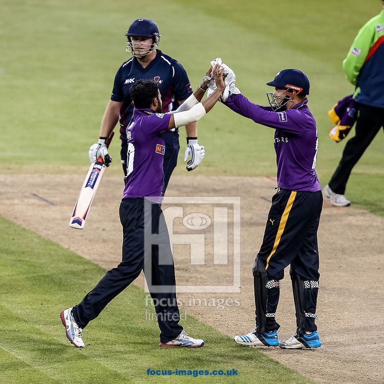 Azeem Rafiq of Yorkshire Vikings (front left) celebrates after taking the wicket of Ben Duckett of Northants Steelbacks (not shown) during the Natwest T20 Blast match at the County Ground, Northampton<br /> Picture by Andy Kearns/Focus Images Ltd 0781 864 4264<br /> 13/06/2014