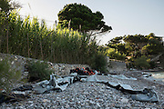 Remains of rubber boats and life preservers that brought refugees from Syria to the Greek island of Chios. As soon as they landed they slit the boat to prevent them being sent back out to sea. Each boat brought 50 refugees across the Aegean from Turkey, a five hour crossing.