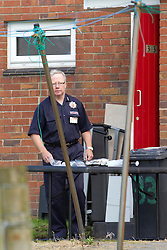 © Licensed to London News Pictures. 05/09/2012 . Horwich , UK . Police seal and evacuate a terrace on Cheriton Gardens, Horwich , after they found suspicious substances whilst executing a warrant , as part of of an investigation into the possession and distribution of indecent images . Investigating officers and fire crew carry out a search of 33 Cheriton Gardens . Photo credit : Joel Goodman/LNP
