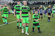 Forest Green Rovers Joseph Mills(23) with mascot during the EFL Sky Bet League 2 match between Forest Green Rovers and Notts County at the New Lawn, Forest Green, United Kingdom on 9 February 2019.