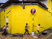 16 NOVEMBER 2016 - GEORGE TOWN, PENANG, MALAYSIA: Boys play in an alley in the Little India section of George Town, Penang, Malaysia. George Town is a UNESCO World Heritage city and wrestles with maintaining its traditional lifestyle and mass tourism.       PHOTO BY JACK KURTZ