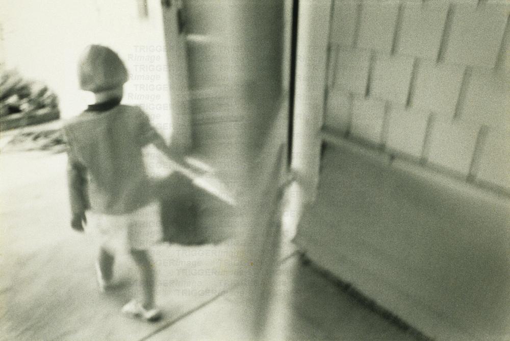 boy by singing door