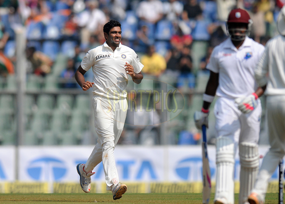 Ravichandran AShwin of India runs to celebrate the wicket of Darren Bravo of West Indies during day one of the second Star Sports test match between India and The West Indies held at The Wankhede Stadium in Mumbai, India on the 14th November 2013<br /> <br /> This test match is the 200th test match for Sachin Tendulkar and his last for India.  After a career spanning more than 24yrs Sachin is retiring from cricket and this test match is his last appearance on the field of play.<br /> <br /> Photo by: Pal PIllai - BCCI - SPORTZPICS<br /> <br /> Use of this image is subject to the terms and conditions as outlined by the BCCI. These terms can be found by following this link:<br /> <br /> http://sportzpics.photoshelter.com/gallery/BCCI-Image-Terms/G0000ahUVIIEBQ84/C0000whs75.ajndY