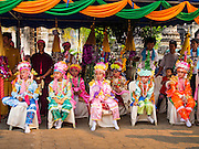 "05 APRIL 2015 - CHIANG MAI, CHIANG MAI, THAILAND: Tai Yai boys being ordained as Buddhist monks watch a folklore show during the second day of the three day long Poi Song Long Festival in Chiang Mai. The Poi Sang Long Festival (also called Poy Sang Long) is an ordination ceremony for Tai (also and commonly called Shan, though they prefer Tai) boys in the Shan State of Myanmar (Burma) and in Shan communities in western Thailand. Most Tai boys go into the monastery as novice monks at some point between the ages of seven and fourteen. This year seven boys were ordained at the Poi Sang Long ceremony at Wat Pa Pao in Chiang Mai. Poy Song Long is Tai (Shan) for ""Festival of the Jewel (or Crystal) Sons.    PHOTO BY JACK KURTZ"