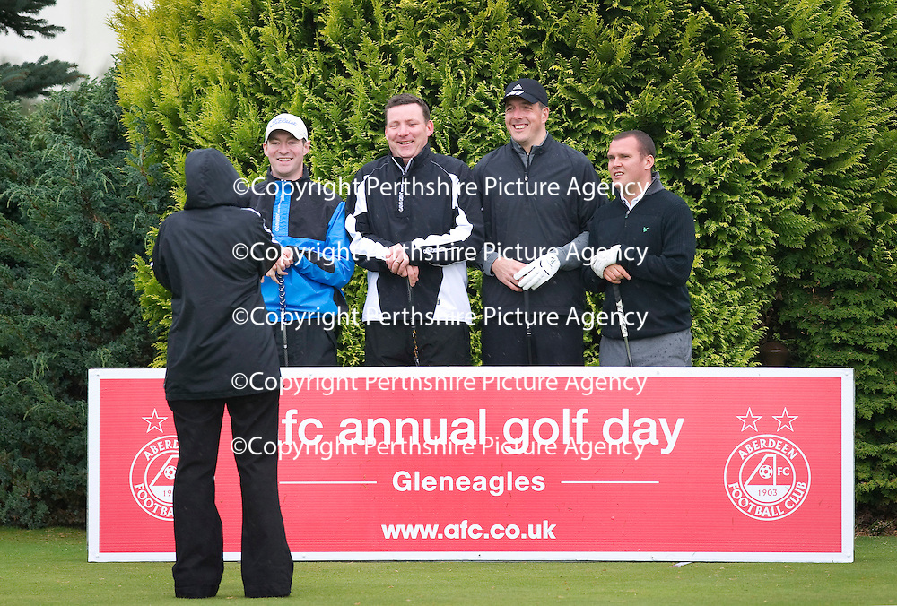 Aberdeen FC Golf Day at Gleneagles....21.09.11<br /> After a miserable night losing to East Fife in the League Cup, Aberdeen's players faced a miserable day at Gleneagles as heavy wind and rain greeted them for the golf day....Pictured  Jamie Langfield (2nd from right) with his team<br /> Picture by Graeme Hart. <br /> Copyright Perthshire Picture Agency<br /> Tel: 01738 623350  Mobile: 07990 594431