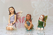 Three Angel Figures on white background