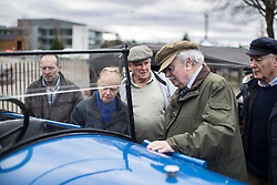 © Licensed to London News Pictures. 28/01/2018. Weybridge, UK. Visitors to Brooklands Museum admire a 1925 Trojan Utility as members of The Vintage Sports-Car Club take part in New Year driving tests round the historic motor racing circuit. Photo credit: Peter Macdiarmid/LNP