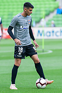 Newcastle Jets defender Johnny Koutroumbis (18) during warm up at the Hyundai A-League Round 6 soccer match between Melbourne City FC and Newcastle Jets at AAMI Park in Melbourne.