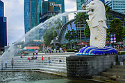 "21 DECEMBER 2012 - SINGAPORE, SINGAPORE:  The Merlion in Merlion Park in Singapore. The Merlion is a mythical creature with the head of a lion and the body of a fish, used as a mascot and national personification of Singapore. Its name combines ""mer"" meaning the sea and ""lion"". The fish body represents Singapore's origin as a fishing village when it was called Temasek, which means ""sea town"" in Javanese. The lion head represents Singapore's original name ? Singapura ? meaning ""lion city.""    PHOTO BY JACK KURTZ"